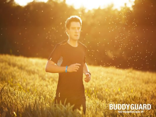 Young man is running in nature at the sunset.